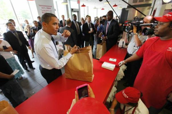 Barack Obama orders hamburgers at Five Guys on 5/29/09 - AP Photo/Gerald Herbert