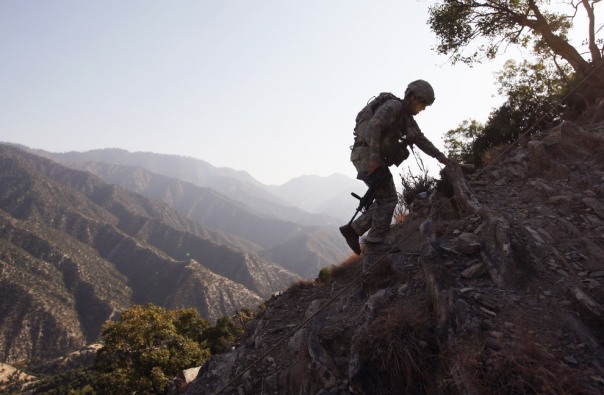 U.S. Army SFC Isaac Migli, 26, walks up a mountainside towards an American outpost in the Korengal Valley October 24, 2008 in the Kunar Province of eastern Afghanistan - John Moore/Getty Images